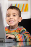 Funny little boy with laptop — 图库照片