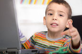 Little boy with laptop shows — Stok fotoğraf