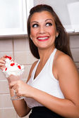Beautiful housewife enjoy in dessert — Stock Photo