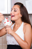 Young satisfied woman eating pudding — Stock Photo