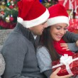 A young couple celebrate Christmas night — Stock Photo