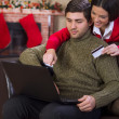 Couple Using Credit Card to E-Shop on christmas night — Stock Photo