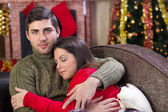 Man embraces a woman sleeping on Christmas Eve — Stock Photo