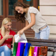 Image of a two young women with shopping bags — Stock Photo