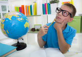 Boy studying about the world,and thinkig something — Stock Photo