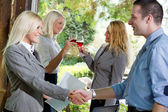 Businesspeople shaking hands in restaurant,focus on the last tw — Stock Photo