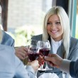 Young succesful businesspeople toasting — Stock Photo