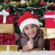 Happy little boy near a Christmas tree — Stock Photo