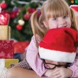 Sister embrace boy on Christmas evening — Stock Photo #33968125