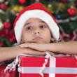 Cute caucasian boy dreaming about presents at christmas time — Stock Photo #33968409