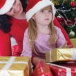 Mother and her daughter with cristmas presents — Stock Photo #33968775