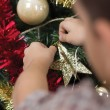 Boy decorating the Christmas tree,shot from behind — Φωτογραφία Αρχείου