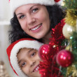 Mom and son next to the Christmas tree — Stock Photo