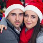 Happy couple at Christmas night — Stock Photo