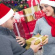 A young couple celebrate Christmas night — Stock Photo #34480065