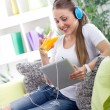 beautiful woman relaxing with music and drink juice — Stok fotoğraf