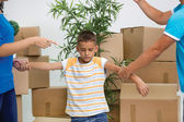 Sad boy while parents quarreling in new home — Stock Photo