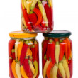 Home Canned Jars of Peppers on white background — Stock Photo
