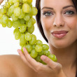 Stock Photo: Beautiful young womand fresh grapes