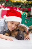 Boy and dog in Christmas night — Stock Photo