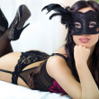 Portrait of attractive sensual young woman in black lingerie on — Stock Photo #35325747