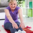 Senior woman exercising at home  — Stock Photo