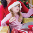 Stock Photo: Mother and her daughter with cristmas presents