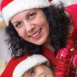 Happy mom and son next to the Christmas tree — Stock Photo