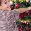 Happy boy decorating the Christmas tree — Foto Stock