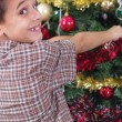 Happy boy decorating the Christmas tree — Φωτογραφία Αρχείου