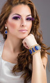 Young beautiful woman make up — Stok fotoğraf
