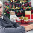 Young smiling man using laptop on Christmas Eve — Stock Photo