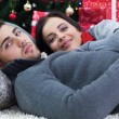 Beautiful couple on Christmas night  — Stock Photo