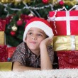 child in Christmas night dreaming about gifts — Stock Photo