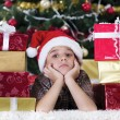 caucasian boy dreaming about presents at christmas time  — ストック写真