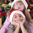 Portrait of happy boy laughing in his sister embrace on Christma — Stock Photo