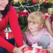 Happy mother and her daughter with Christmas presents — Stock Photo