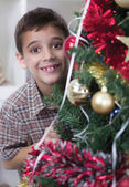 Little boy next to a Christmas tree — Stock Photo