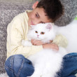 Boy with a white Persian cat at home — Stock Photo