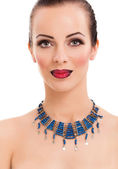 Beautiful woman wearing blue necklace — Stock Photo