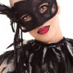 Beautiful young woman in black mysterious venetian mask — Stock Photo