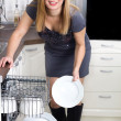 Sexy housewife takes out plates from dishwasher — Foto Stock #37577725