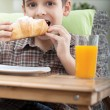 Young boy having breakfast — Stock Photo