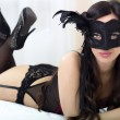 Top view picture of sexy masked girl in black lingerie lying on — Stock Photo