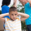 Little boy it can not listen to the parents argue — Stock Photo #39931351