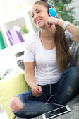Woman wearing headphones and relaxing with digital tablet beaut — Stock Photo