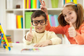 Young brother and sister learning at home,funny concept — Stock Photo