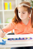 Young girl drawing with watercolors — Stock Photo