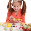 Little girl painting easter eggs — Stock Photo