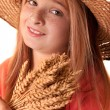Girl with the freckles and straw hat holding in his hand a whe — Stock Photo